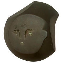 Small Bronze Face Wall Sculpture