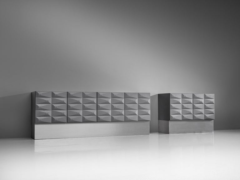 Brutalist credenza, wood and aluminum, Belgium, 1970s.   Modern and clean two-door sideboard cabinet. Two-door panels, each with an exceptional three-dimensional pattern. The continuous pattern gives this bar-cabinet a very strong expression. The