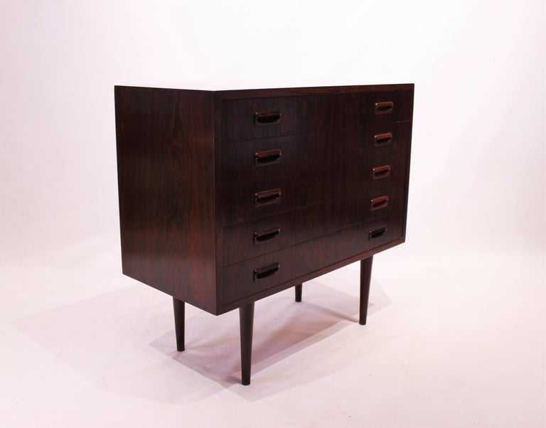 Small chest of drawers in rosewood with five drawers of Danish design from the 1960s. The chest is in great vintage condition.