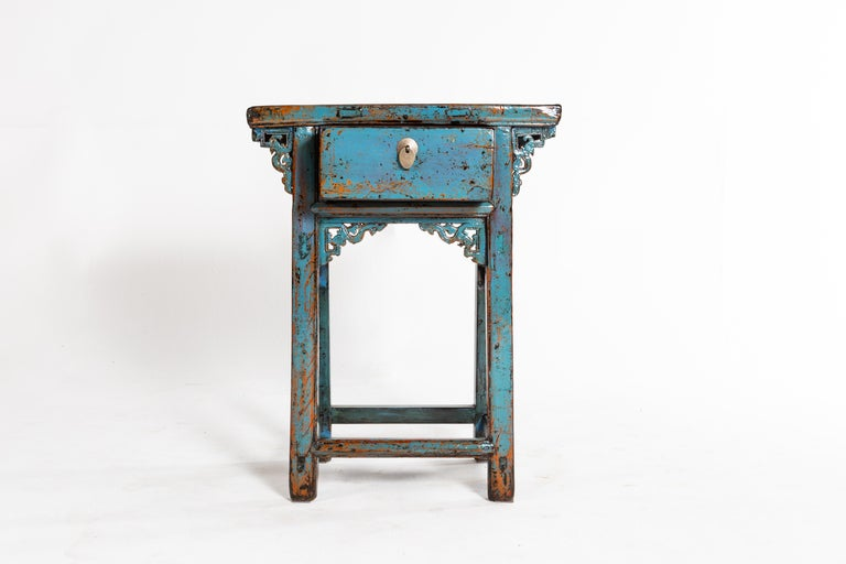 This console table is from Jiang Xu, China and was made from pine wood, circa 1920. The piece features a drawer and blue paint. Wear consistent with age and use.