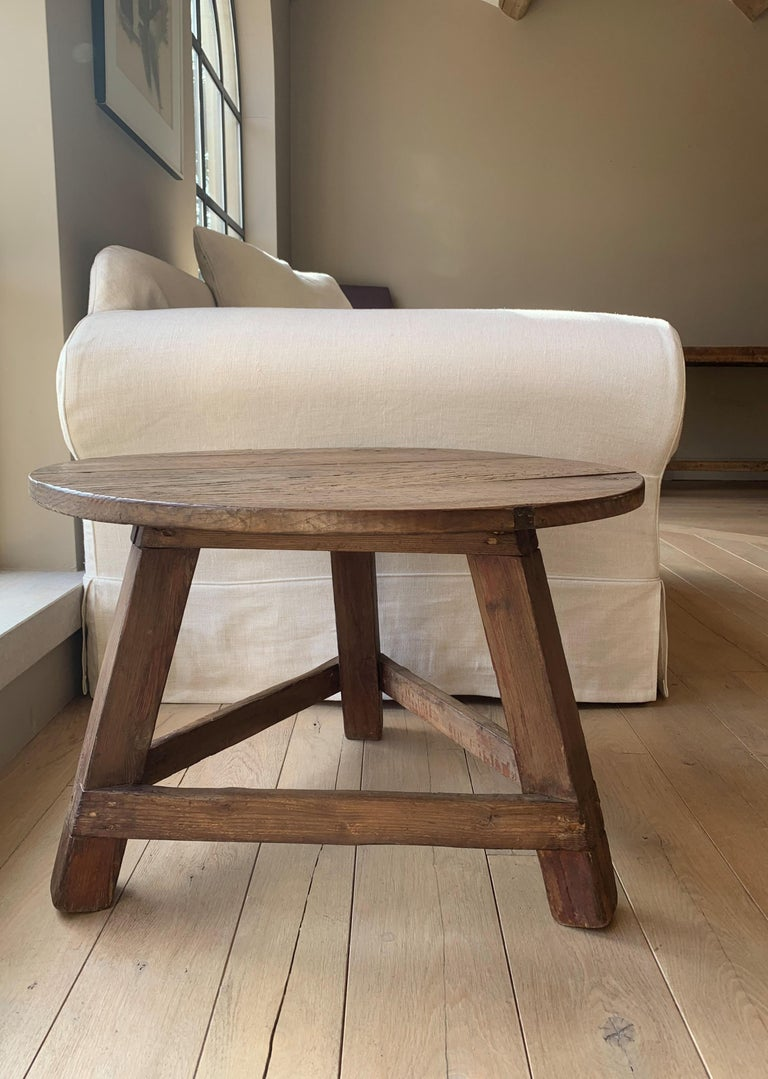 A small Spanish tripod side table. The base in softwood and the top in nicely grained chestnut.