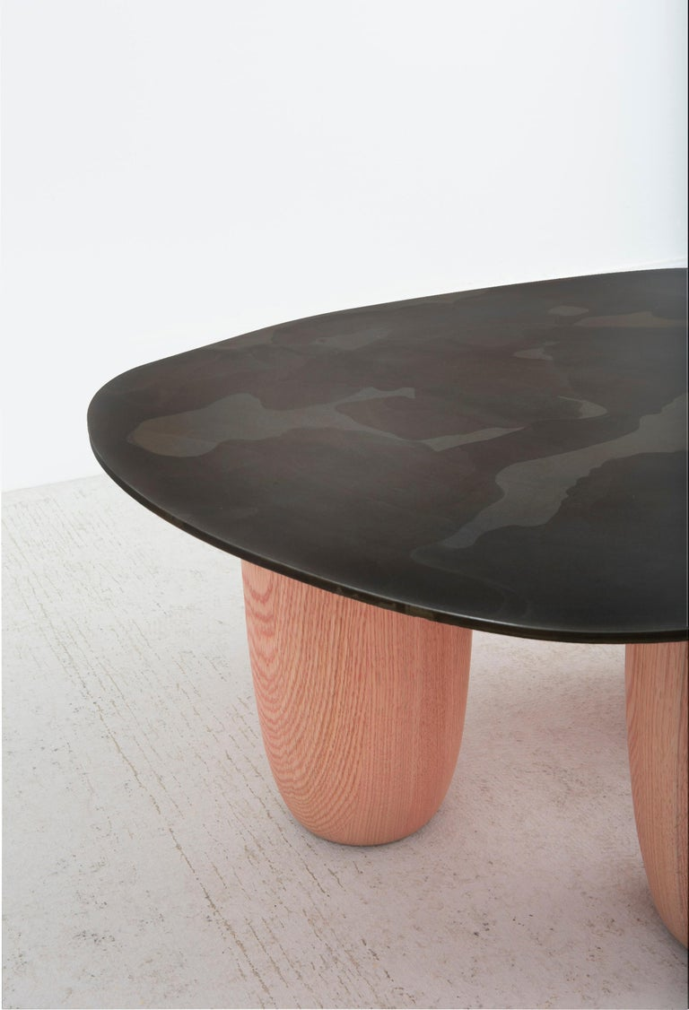 Our small version Sumo table was introduced at Design Miami 2020 paired with its Medium counterpart as shown. The design was influenced by Japanese minimalist aesthetics. Resembling a softened stone as well as a likeness to the strength and stance