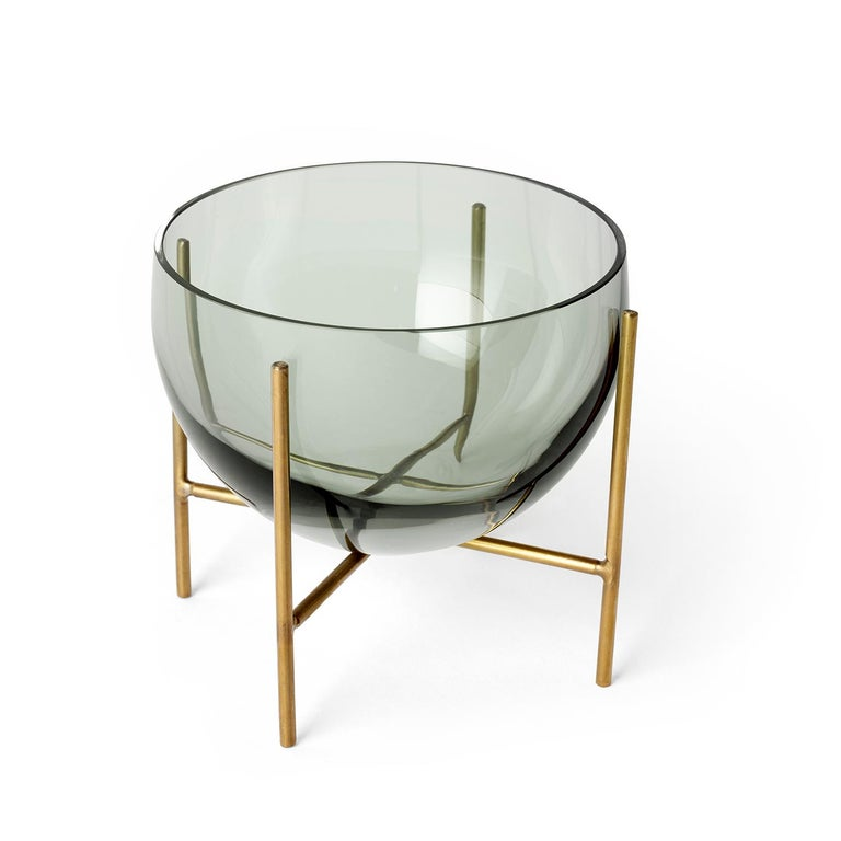 A new addition to the Echasse series by Theresa Arns for Menu, Echasse bowl combines the elegance of a traditional glass bowl with a playful and light expression, created by four slender brass legs that elevate it into the air. The word échasse is