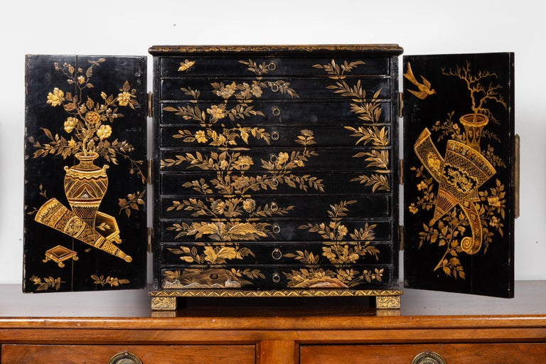 Gilt Small English 1890s Black and Gold Chinoiserie Cabinet with 10 Hidden Drawers For Sale