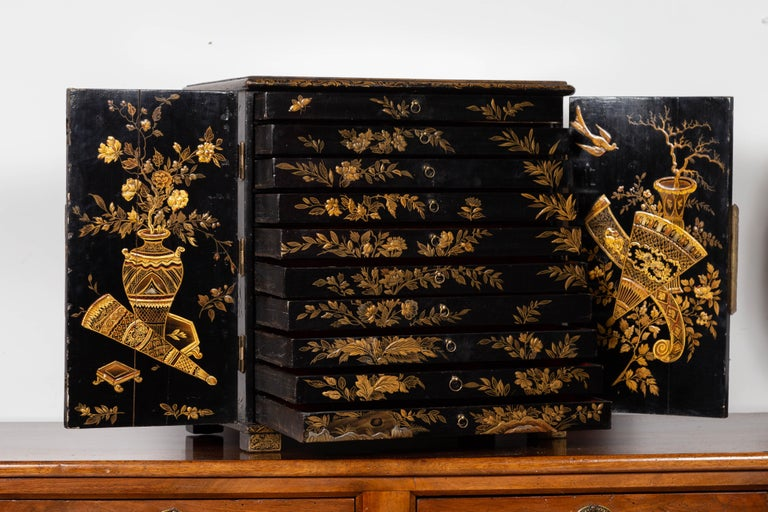 Small English 1890s Black and Gold Chinoiserie Cabinet with 10 Hidden Drawers In Good Condition For Sale In Atlanta, GA