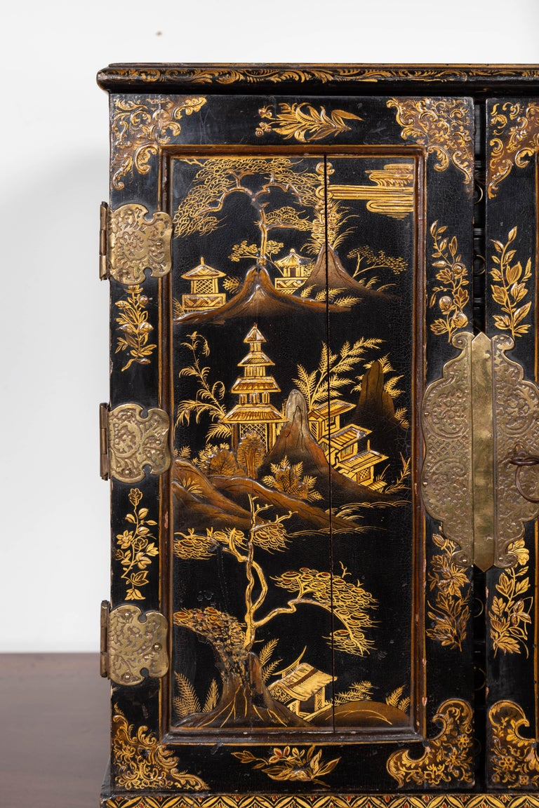 19th Century Small English 1890s Black and Gold Chinoiserie Cabinet with 10 Hidden Drawers For Sale