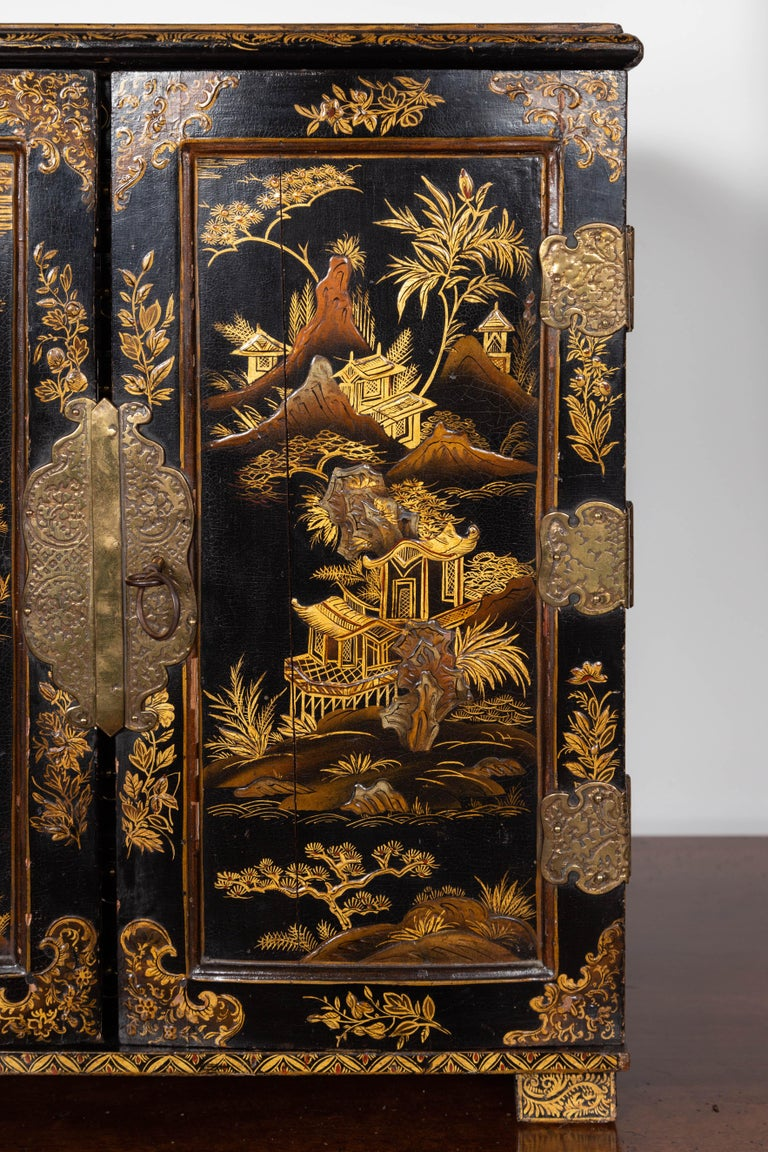 Wood Small English 1890s Black and Gold Chinoiserie Cabinet with 10 Hidden Drawers For Sale