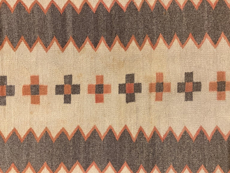 Due to the delicacy and fineness of the weave, it wouldn't be accurate to describe this as a rug. Perhaps it is a transitional Navajo piece that was woven for use as a child's wearing blanket? It is difficult to know for certain, however the beauty