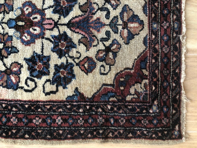 Handwoven one of a kind 19th century floral Persian rug. Beautiful tones of cream and beige with layers of pinks, blue and red. Perfect as an accent rug in living room or bedroom. Bringing a soothing pop of color into any space.