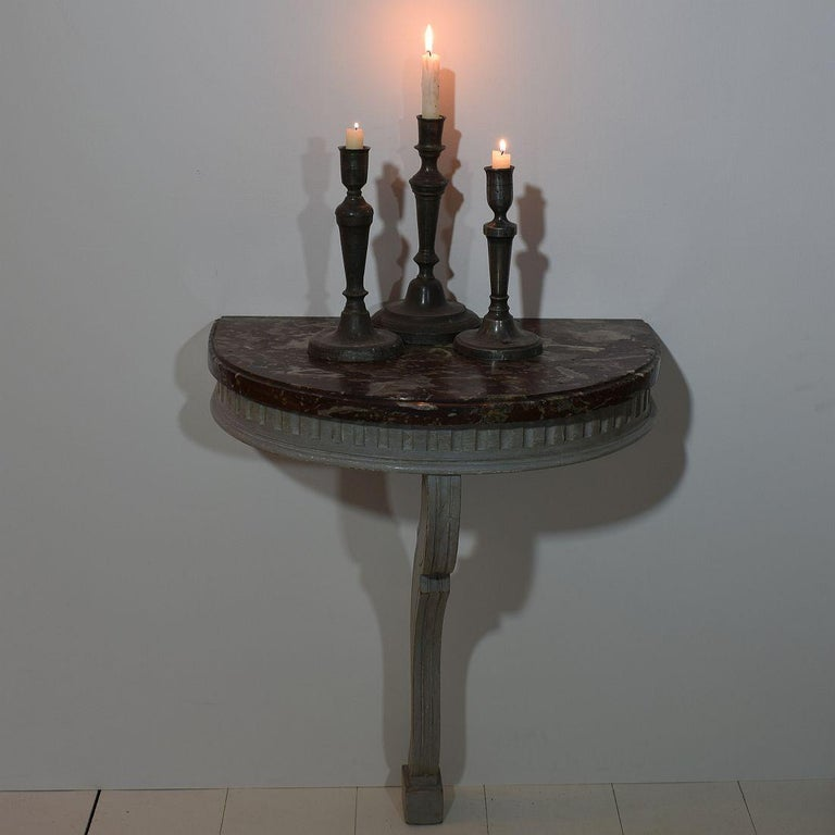 Beautiful small marble-top console table. Nice grey color and rare marble top. France, circa 1750-1800. Weathered and old repairs. Great to use as a nightstand.
