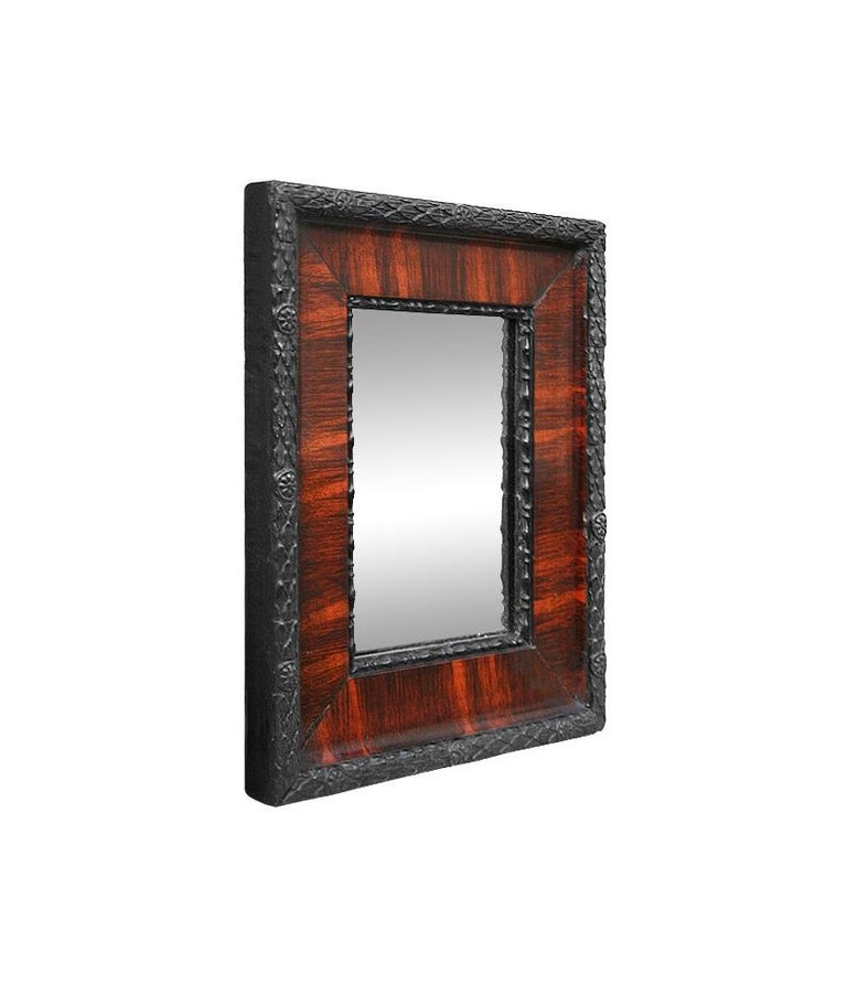 Small French antique mirror, circa 1880. Black antique frame and imitation mahogany wood with decoration laurel leaves and small rosettes. Antique wood back. Antique frame width: 2.16 in / 5.5 cm.
