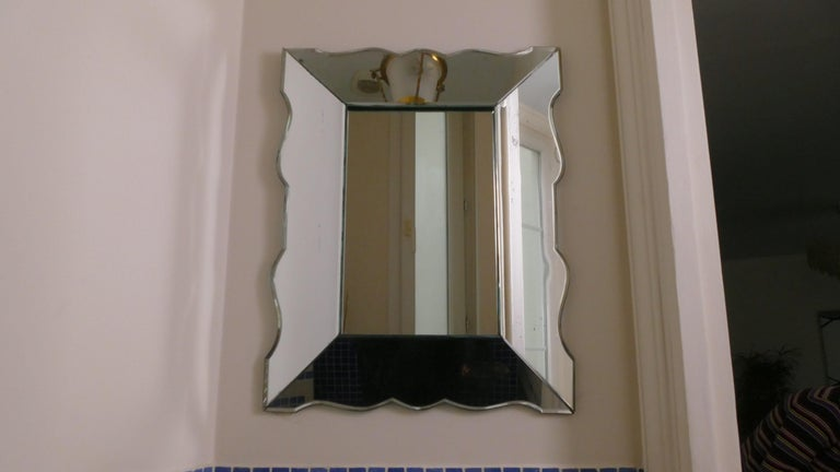 The beautiful patina evident in this 1940s wall mirror imbues the piece with the romance that is often sought-after in vintage décor. Furthermore, the mirror was created in a unique period, showing elements of late Art Deco and early modernism in