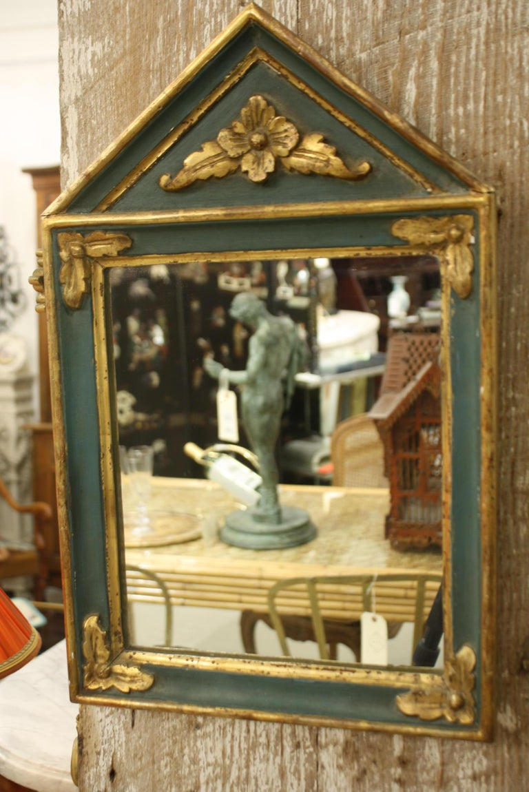 Small French Directoire style parcel gilt and green-painted trumeau mirror.