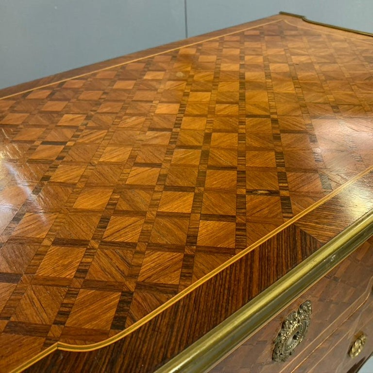 Early 20th Century Small French Kingwood and Geometric Parquetry Commode with Brass Mounts For Sale