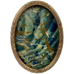 Small French Oval Louis XVI Gilt Frame with Crossed Ribbons Over Reeds