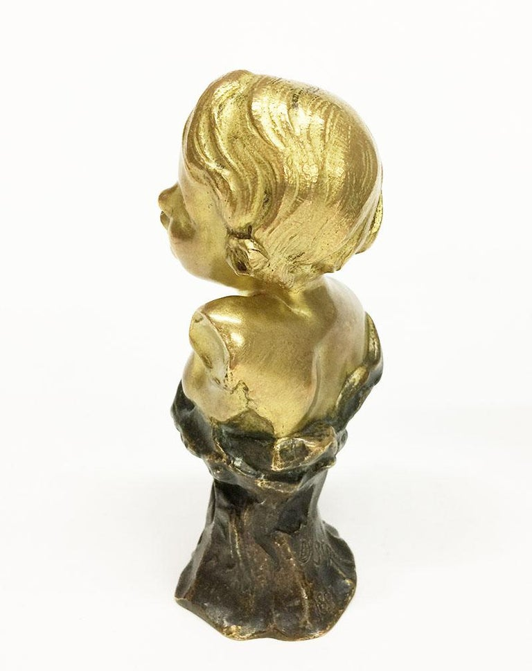 Small antique gilded French bronze bust by Rene de Saint-Marceaux  Named and marked E. Polo and dated 1897 This small gilded bronze is a bust of a child signed D. St. Rene for Rene Saint-Marceaux (Charles Rene Marceaux, French