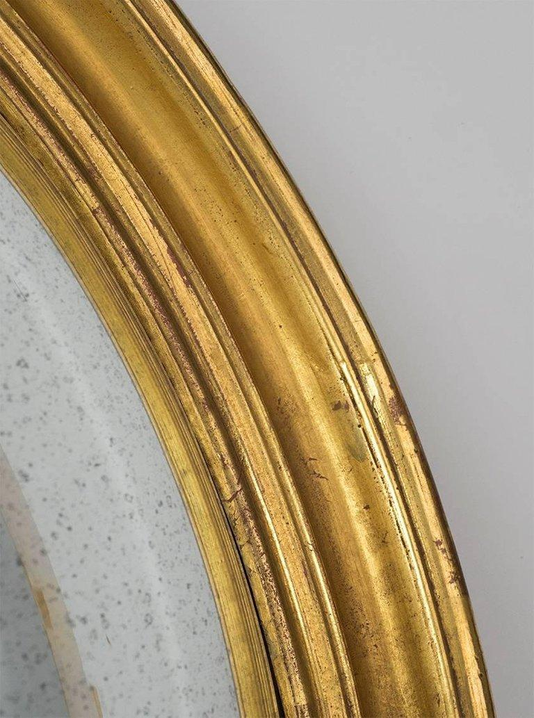 American Small Gilt Oval Frame with Handk Drawn Deep Convex Mirror For Sale