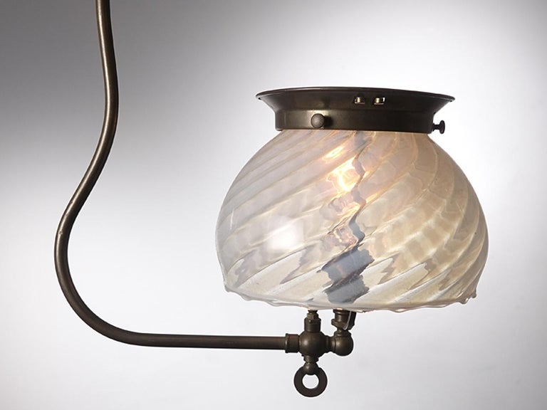 The hand blown 7.5 inch shade on this lamp is just beautiful. The fixture is a simple 1890s gas style that is newly wired to take a single candelabra bulb.
