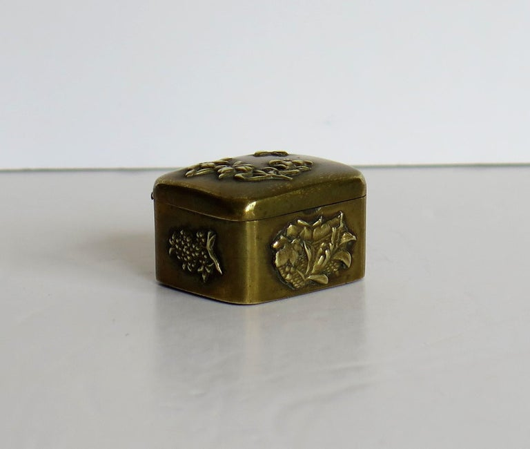 Small Japanese bronze and brass embossed Box with hinged lid 19th C Meiji Period In Good Condition For Sale In Lincoln, Lincolnshire