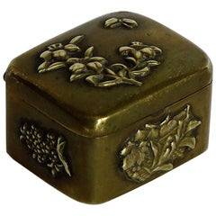 Small Japanese bronze and brass embossed Box with hinged lid 19th C Meiji Period