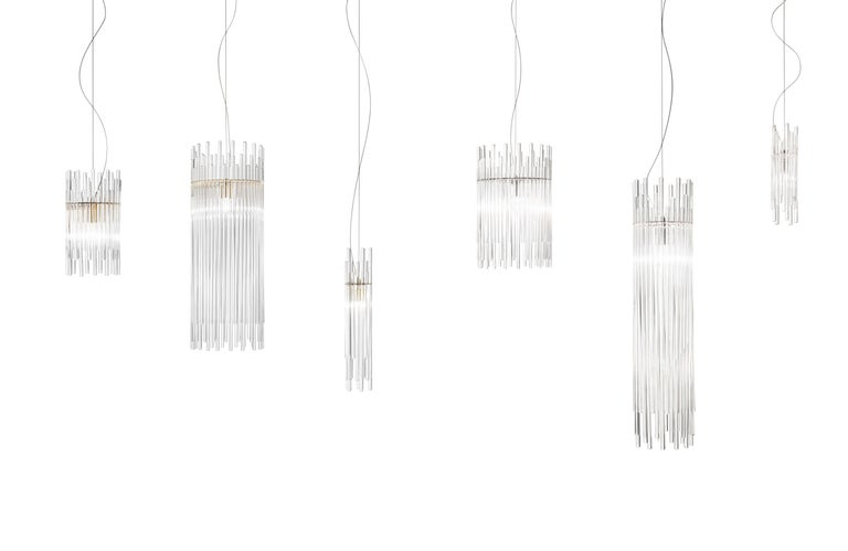 Diadema is a lighting system based on a single element, the rod of pure glass. It takes advantage of the way it reflects and transmits the light, while offering a sense of movement by using rods of different sizes. The metal body allows to offer