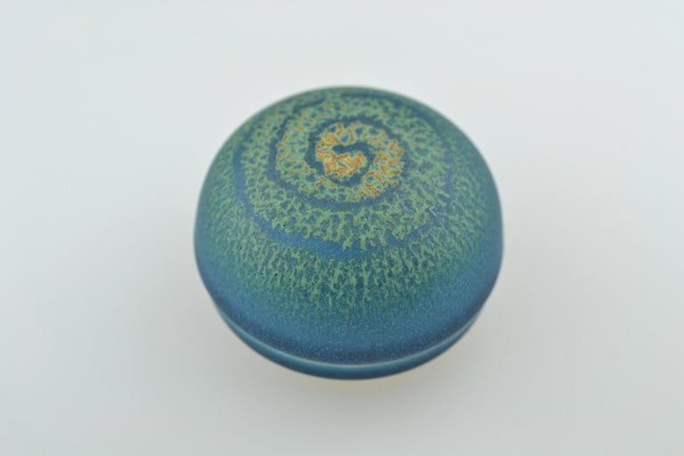 The small ceramic case with a dome-shaped lid resting on a small circular stand is for storing incense (kôgô). Beautiful kôgô are used for representational purposes within the tea ceremony, after the incense is placed in the charcoal brazier during