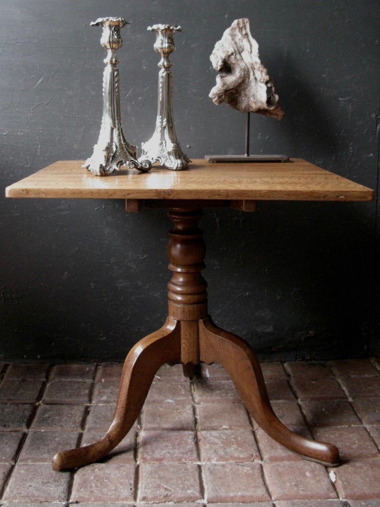 Lovely occasional small oak tripod table origin England, honey color.