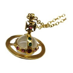 Small lucite, gilt metal and coloured paste 'orb' pendant, V Westwood, 1980s