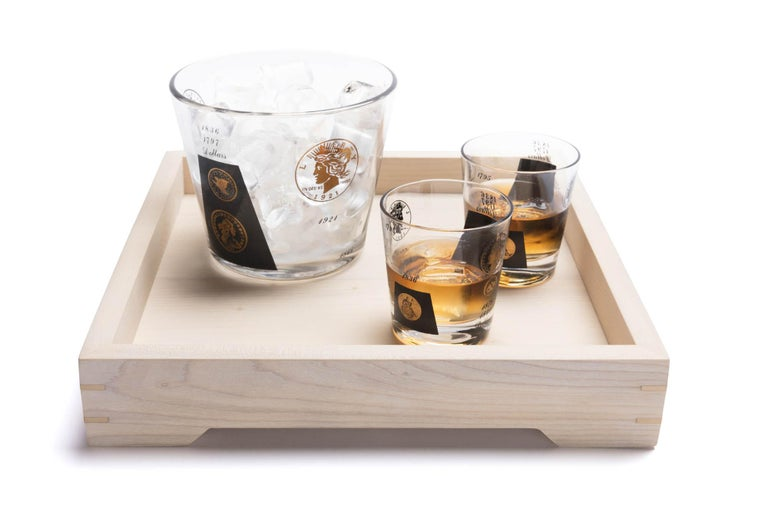 With the White Magnolia Wood and Brass Small Serving Tray,