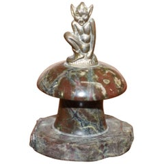 Small Marble Statue with a Little Bronze Pixy Sitting on Top of a Polished Rock