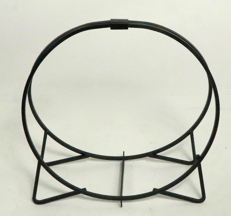 Circular mid century wrought iron holder of diminutive scale. Well made, and in very good condition, clean and ready to use.