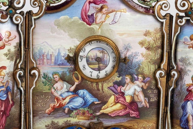 Small miniature screen in gilded bronze in the Louis XV style with three leaves, with hand painted enamel plates representing a painting of allegorical scenes, a small clock thrones in the middle of this screen.