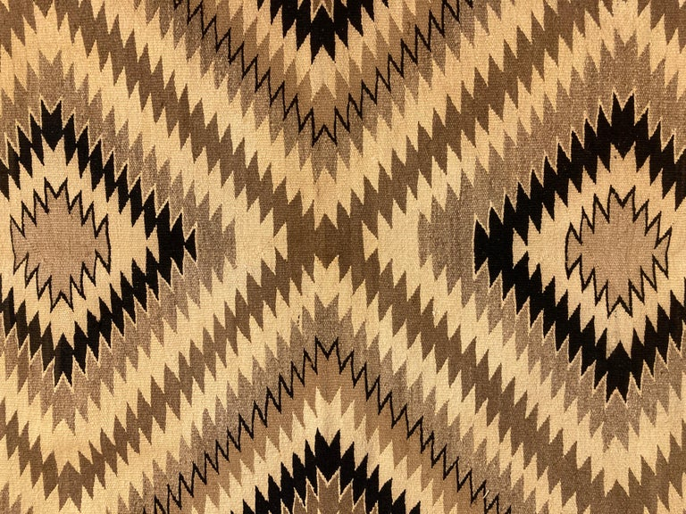 Small, but with powerful graphics, this delicately colored and finely woven Navajo rug would be great on the floor or wall. Unusual for its lack of red, this piece would fit in well in most contemporary or Western-styled settings.