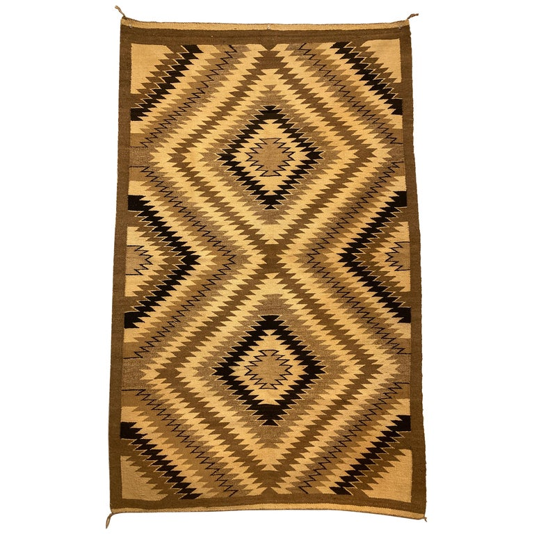 Small Navajo Rug in Earthtone Colors For Sale