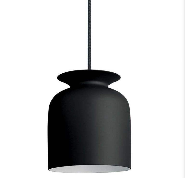 Small Oliver Schick Ronde pendant in black matte for Gubi. Designed by Oliver Schick, the Ronde pendant has an industrial, yet friendly look that is well-suited for both home decor and professional environments. Executed in spun aluminum with