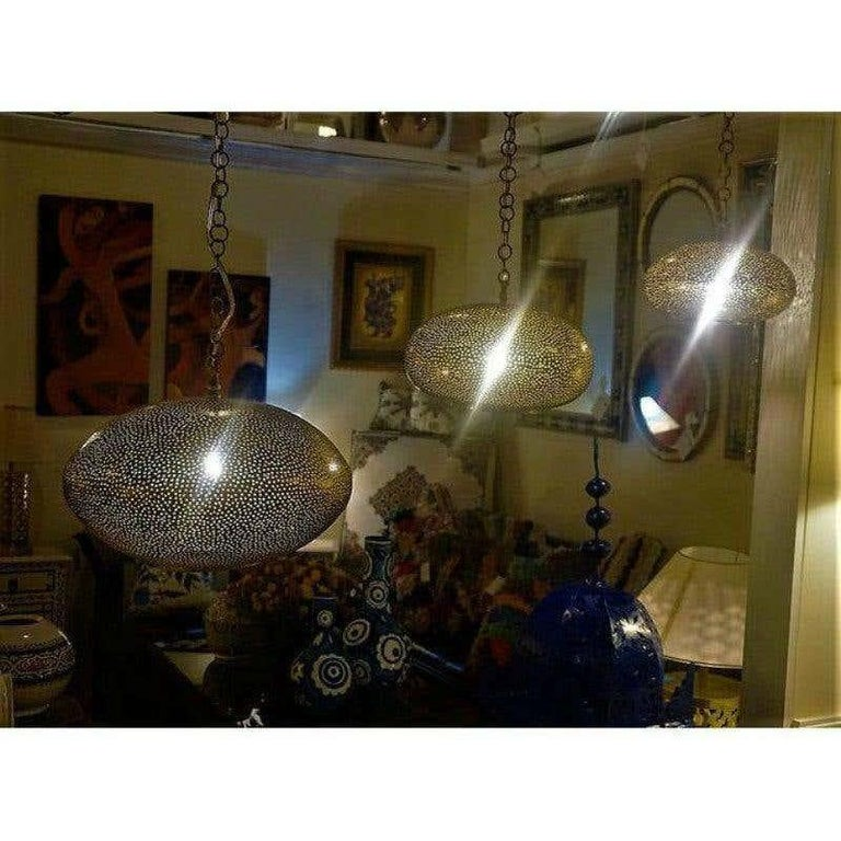 Late 20th Century Small Oval Gold Brass Modern Pendant Chandeliers, Set of Three For Sale
