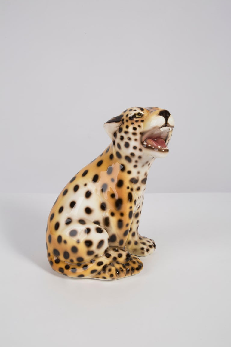 Painted ceramic, perfect condition. Beautiful and unique decorative small sculpture. Leopard was produced in 1960s in Italy.
