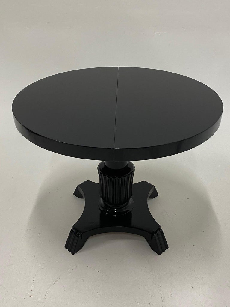 Chic very versatile dining table that is 35.5 diameter round when closed and has one leaf so when open the shape becomes oblong. Dimensions below. Table has a mechanism underneath to adjust height from 24
