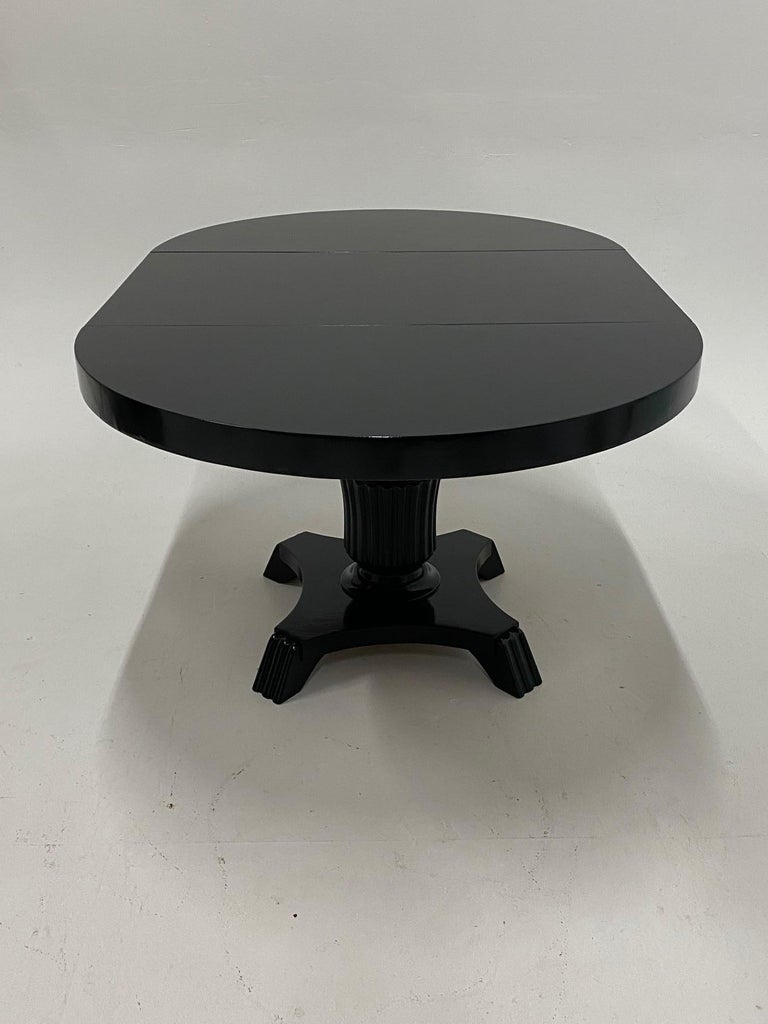 Mid-20th Century Small Round and Oval Hollywood Regency Style Black Laquer Dining Table