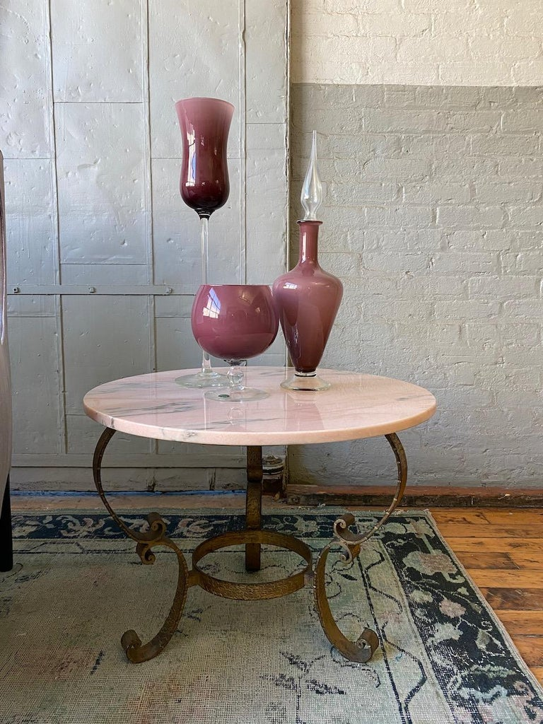 Small round coffee table with gold gilt base and pink marble top. Spanish 1950s.