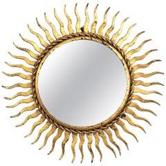 Small Scale Sunburst Mirror in Gilt Wrought Iron