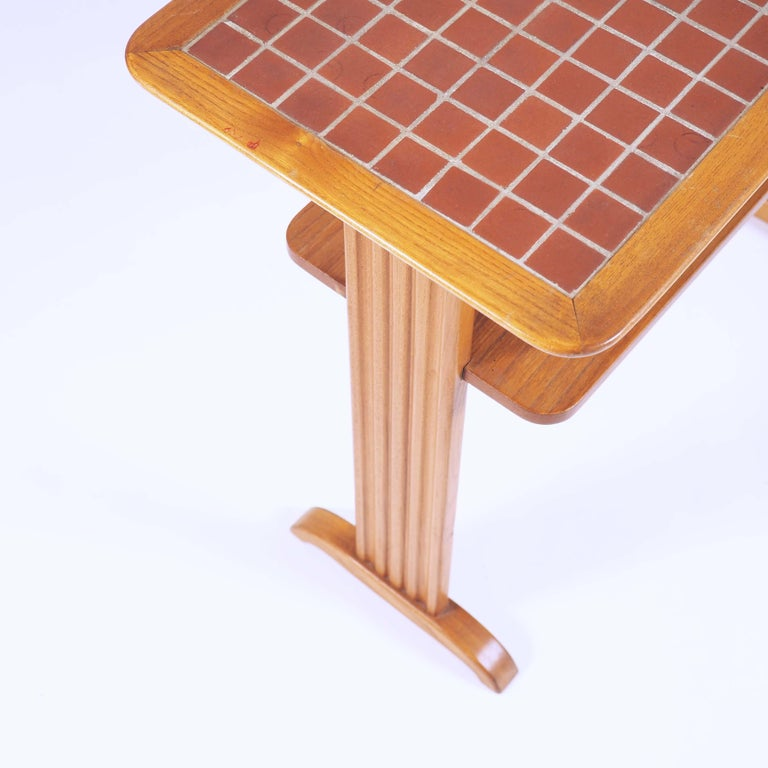 This small table in elmwood and terracotta mosaic (Called