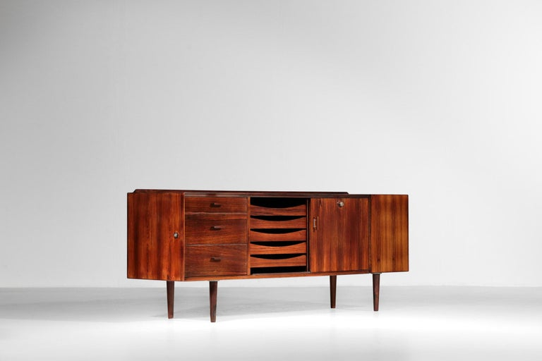 Small Scandinavian sideboard by Arne Vodder for Sibast.  This sideboard is made of rosewood and composed of 3 drawers, 5 drawers paper and 2 doors on the right.  Really nice manufacture. No key.