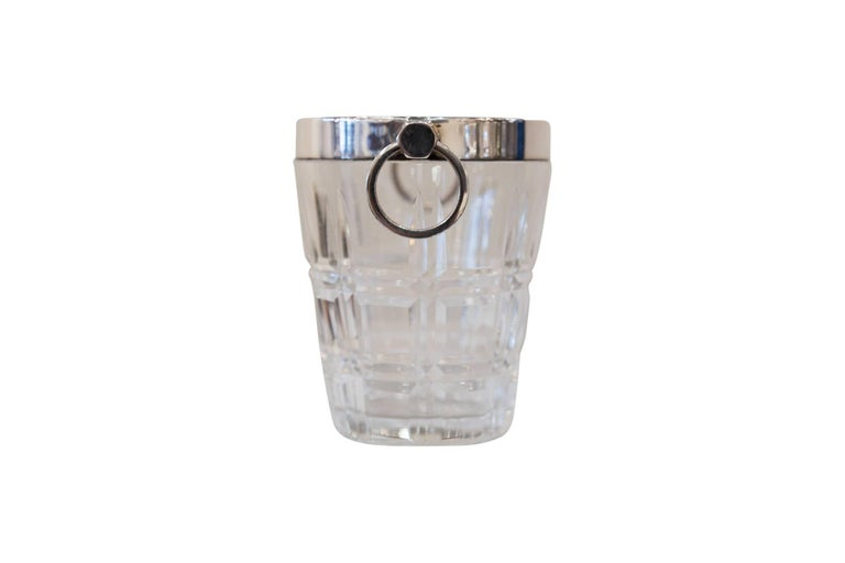 A small silver plated glass ice bucket, circa 1890. This piece is the perfect accessory that adds sophistication to any bar or lounge!