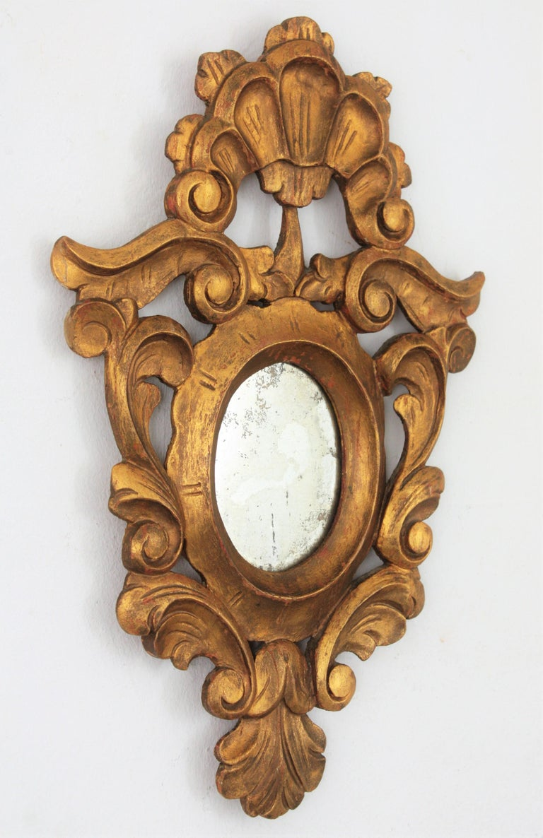 Hand-Carved Small Spanish Rococo Style Giltwood Mirror For Sale