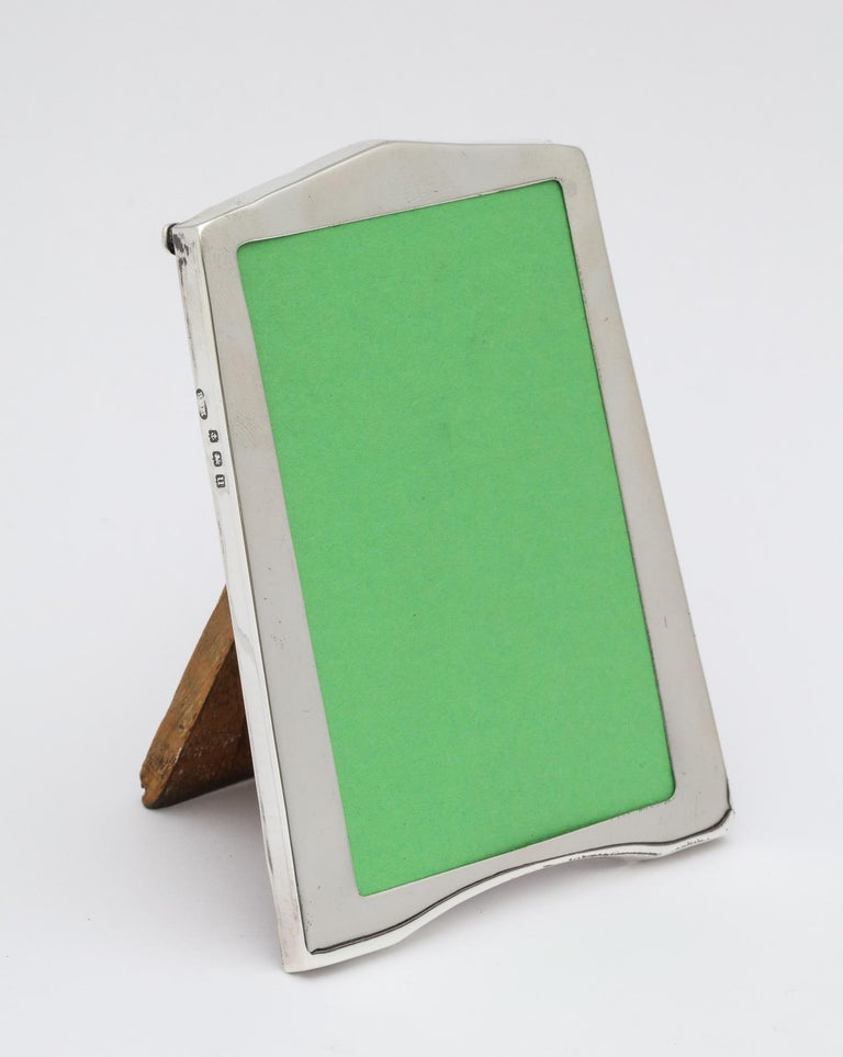 Small, sterling silver, Art Deco picture frame with wood back, Birmingham, England, 1911, Baldwin and Marriott - makers. Measures 4 1/2 inches high (at highest point) x 3 1/8 inches wide (at widest point) x 2 1/2 inches deep (when easel in in open