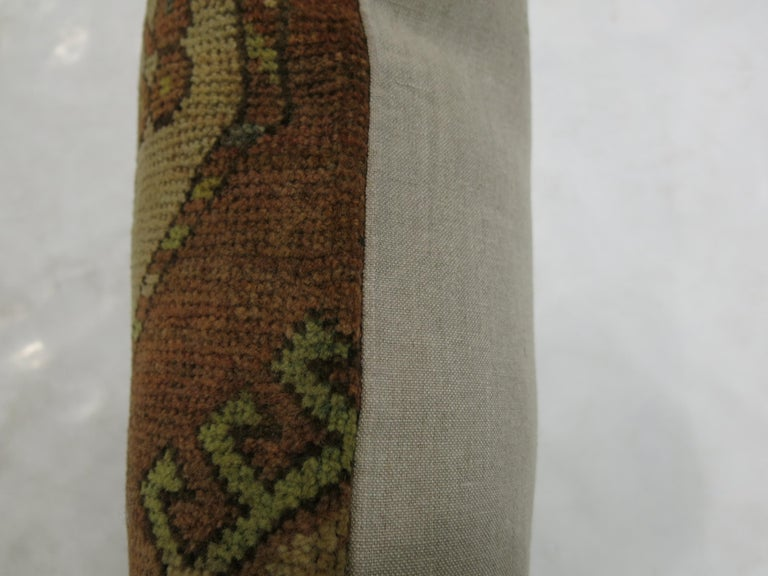 Pillow made from a 19th-century antique Ersari rug with cotton back.  Measures: 14