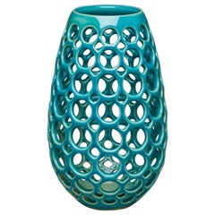 Small Turquoise Pierced Elongated Teardrop Shaped Tabletop Sculpture