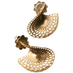 14 Karat Yellow Gold Small Twisted Disk Stud Earrings.
