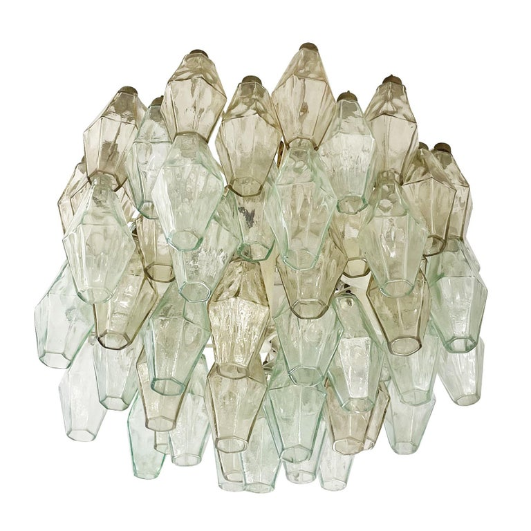 Mid-century chandelier by Venini made with their iconic poliedri Murano glasses. The glasses are a mix of light green ones and amber ones mounted on a white lacquered frame. Ready to hang on a chain.  Condition:  Excellent vintage condition,